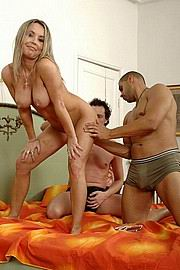 interracial threesome fucking on the bed